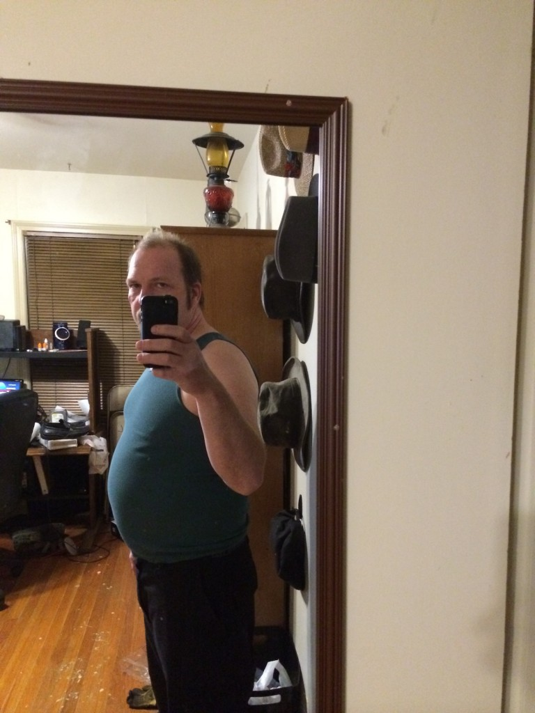 Workout Week 1: SIde Photo. Good Lord, what is that hanging off the front of me?